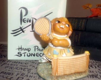 Vintage (1980s) PenDelfin rabbit figurine named Annette the Tennis Pro model 3015204. Hand-painted, made in England. Original box and label.