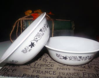 Pair of vintage Corelle Winding Gate cereal, soup, salad bowls. Black flowers and scrolls on white.