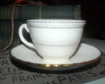 Early mid-century (1940s) mismatched tea set (flat cup with saucer). Grindley Cream Petal Imperial saucer with Woods England cup.