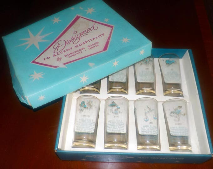 Early mid-century (late 1940s) Dominion Glass Co Canada boxed set of 8 signs of the zodiac tumblers, turquoise, gold rims