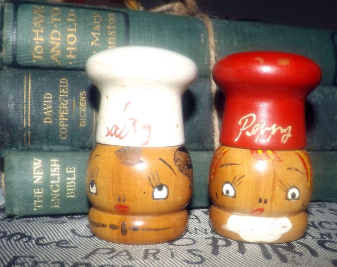 Mid-century (1950s) Salty and Peppy hand-painted, wooden salt and pepper shakers. Chef's hat screws off to fill.
