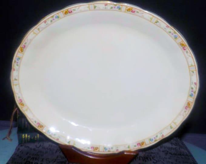 Early mid-century (mid-late 1940s) Grindley Carmona large turkey | meat platter. Multicolor florals, mustard rings. Cream Petal Ironstone