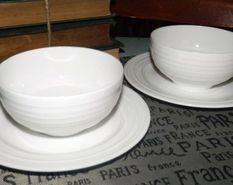 Mikasa Swirl White stoneware of 2 cereal bowls and 2 side plates. All-white, embossed rings. Discontinued 2006.