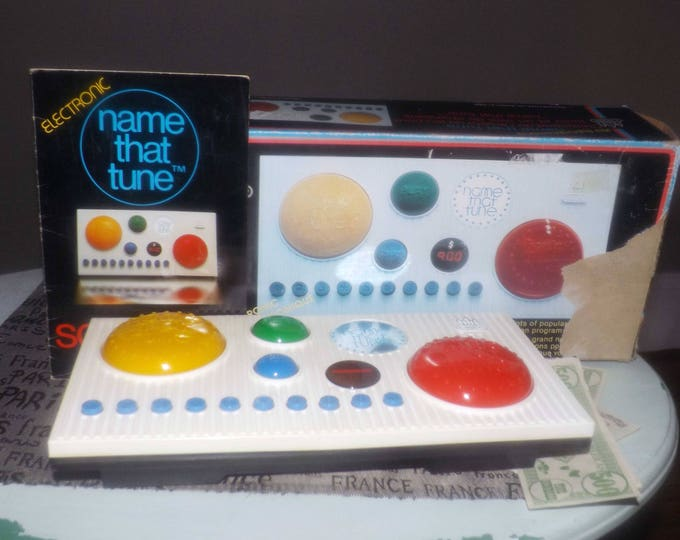 Vintage (1979) Castle Toys electronic Name That Tune game console, songbook, play money.