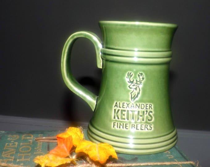 Vintage Alexander Keith's Fine Beers ceramic beer stein   tankard.  Green glaze, impressed logo.  Limited-edition Canadian stein.