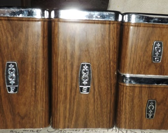 Vintage (1970s) EKCO brown woodgrain finish stackable canisters with lids and black pull tops.  Made in Canada