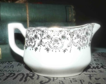 Early mid-century (1940s) Canonsburg USA Golden Fragrance creamer or milk jug. 22-karat gold floral filigree and edge.