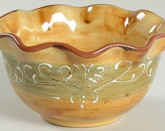 Pier 1 Maroma Amber cereal, soup or salad bowl.  Ruffled edge, embossed white scrolls, green band. Hand-painted terracotta. Retired in 2012.