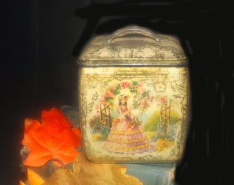 Antique (1910s) BW&M Ltd. | The Metal Box Company sweets| biscuits tin with lid.  Woman in pink crinoline, tree, garden, gold flowers.