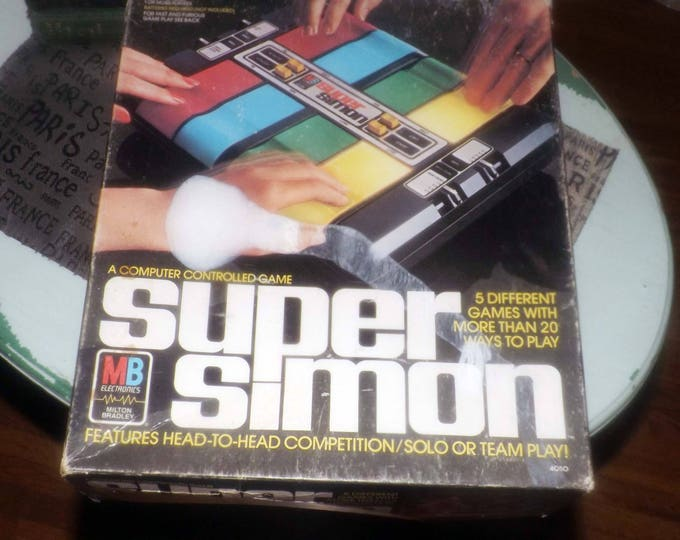 Vintage (1979) Super Simon electronic board game published in Canada by Milton Bradley. Complete and working.