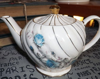 Mid-century (1950s) Sadler hand-decorated tea-for-two teapot. Gold swirl body and gold accents, blue roses.