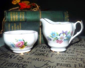 Vintage (1970s) Queen Anne England mini creamer | milk jug or open sugar bowl. Multicolored flowers, scalloped gold edge, accents.