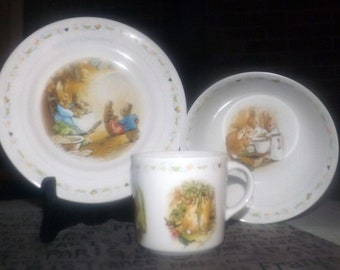 3-piece Wedgwood child's | baby dinnerware set Peter Rabbit. Plate, cereal | oatmeal bowl, handled mug. Flopsy, Mopsy. Made in England.