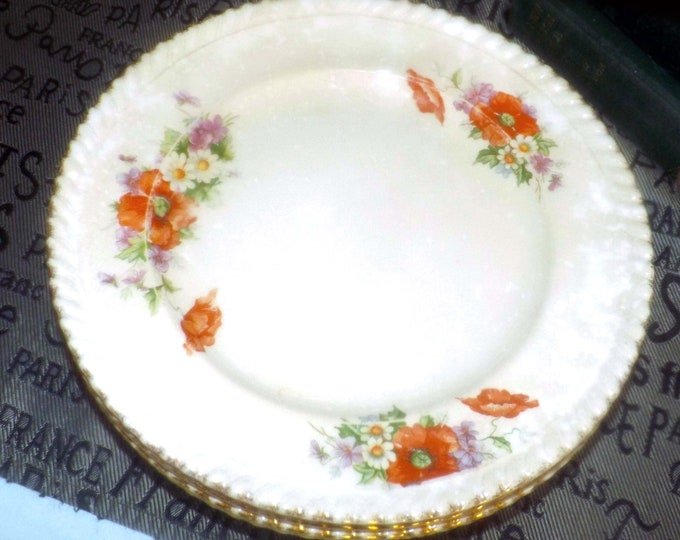 Mid-century Sovereign Potters 994-50 salad or side plate. English ironstone decorated in Canada. Sold individually.