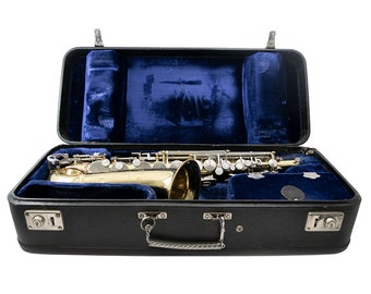 Vintage (1980s) King Cleveland 613 Alto Saxophone with original case. Clear serial number. Working well. Made in USA.