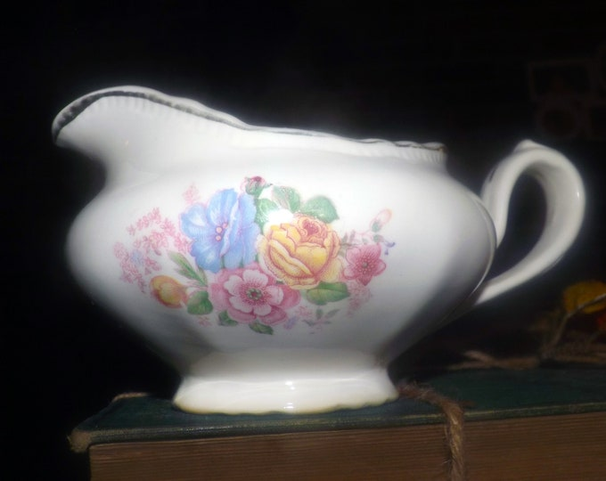 Early mid-century (1947) Sovereign Potters Barbara Ann 880-47 gravy or sauce boat. Multicolor center florals, gold edge