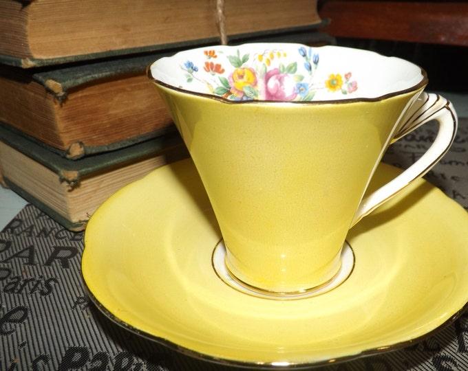 Quite vintage (1930s) Royal Grafton AB Jones yellow tea set with art-deco handle, gold edge, accents, multicolor florals. Pretty.