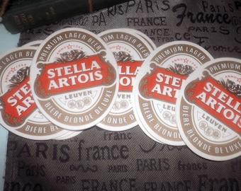 Set of 5 vintage (1980s) Stella Artois oval, heavy cardboard beer coasters.  Stella Artois logo and wording on both sides.