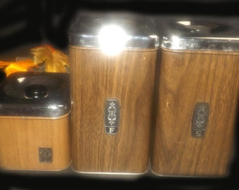 Vintage (1970s) EKCO brown faux woodgrain canisters. Set of three canisters: sugar, flour and coffee.