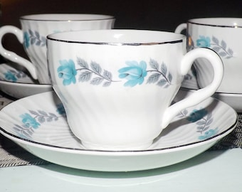Early mid-century (1940s) Barratts Delphatic White tea set (flat cup with matching saucer). Blue roses, platinum edge, swirled body.