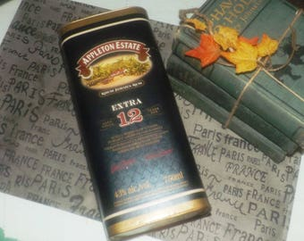 Vintage (mid 1990s) Appleton Estate 12-year old Jamaica Rum embossed tin with metal base and lid. Cardboard covering. Nice home bar decor!