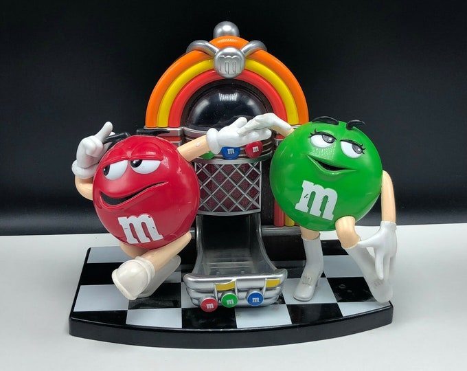 """Vintage (late 1980s) M&M's Candy Dispenser known as the """"Rock 'n Roll Jukebox"""". Ms. Green and Mr. Red dancing!"""