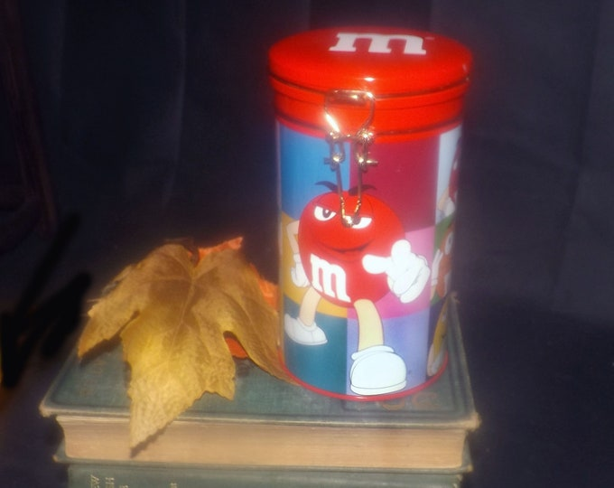M&Ms | Mars Inc. candy tin. Clasp seal lid. Too cute.