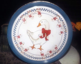 Vintage (1987) round cookie tin. White geese, red ribbons, blue checks. American Trends Corp.
