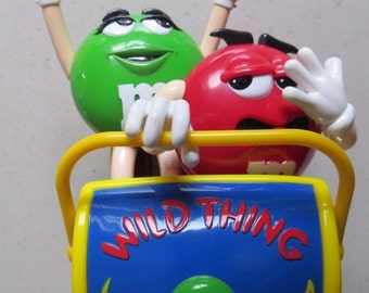 Vintage (1991) First issue M&Ms Wild Thing candy dispenser feat. Ms. Green (Wild Thing) and Mr. Red.