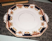 Almost antique (early 1920s) Royal Stafford Imari cobalt and gold, art-nouveau handled cake plate. Hand-painted marked 6068 to base.