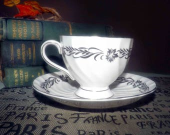 Vintage (1964)  Royal Tuscan | Tuscan China Silver Heritage tea set (footed cup with matching saucer). Silver florals, leaves, edge.