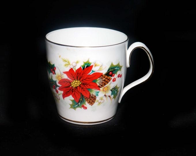 Vintage (1976) Royal Albert Poinsettia Christmas coffee or tea mug made in England. Gold edge, accents.