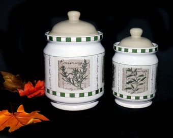Pair of vintage Himark Savory Tyme vacuum-seal canisters. One large, one small. Various herbs and herb wording.