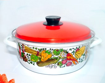 Retro vintage (1970s) Austria Email enamelware dutch oven with lid. Retro vegetables on white with an orange lid.