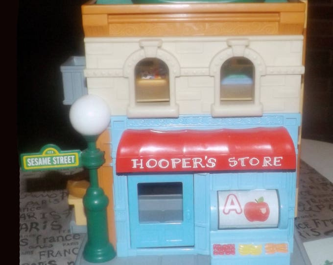 Sesame Street Workshop | Hoopers Store made by Hasbro in 2010. Folding carry case, pop-up Oscar in garbage can, helpful carry handle.