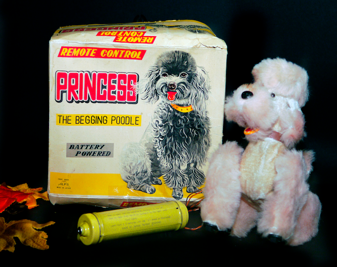 Mid century Princess the Begging Poodle remote-control dog made in Japan by Alps. Working with original box.