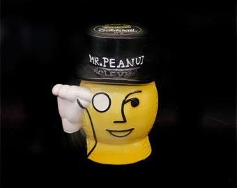 Vintage (1980s) Mr. Peanut Planters Peanuts 300g ceramic cookie jar.  Monocled Mr. Peanut. Removable top hat lid, rubber lid seal.