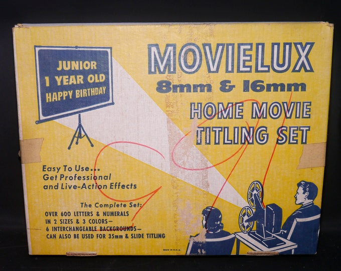 Mid-century Movielux Home Movie Titling Set made in USA by Joseph Struhl Co. Complete and largely unused with instructions.