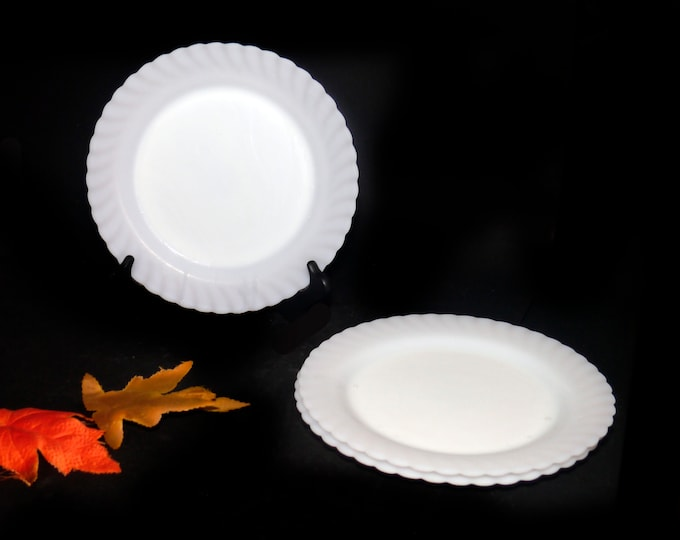 Vintage (1980s) Arcopal Trianon dinner plate. All-white milk glass made in France. Sold individually.