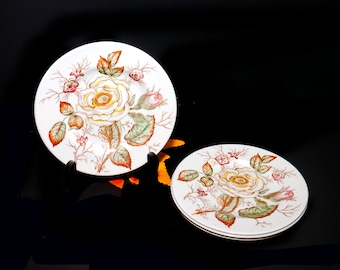 Set of mid-century John Maddock Old Rose bread, dessert, side plates made in England. Set of three or four plates.