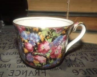 Vintage (1930s) Royal Winton Grimwades Majestic hand-painted black floral chintz orphan tea cup made in England. Flawed (see below).
