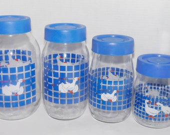 Set of four vintage (1980s) Carlton Glass Marmalade white geese blue checks canisters with removable blue plastic lids. Retro kitchen decor.