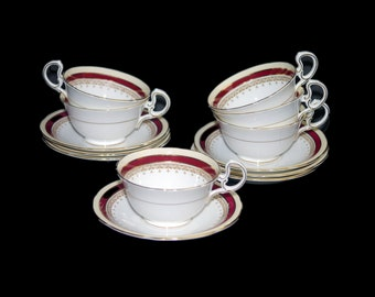 Vintage (1960s) John Aynsley Wendover Maroon bone china cup and saucer set made in England. Sets sold individually.