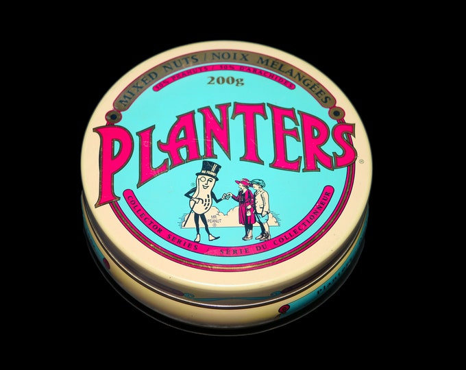 Vintage (1991) Planters Peanuts Mixed Nuts 75th Anniversary of Mr. Peanut round tin. Wording appears in English and French.