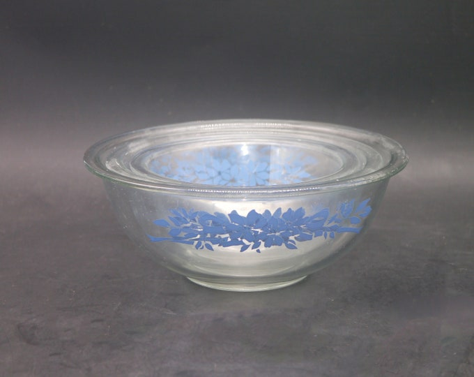 Set of three vintage (1980s) Pyrex PYR39 blue-and-white glass mixing bowls made in the USA. Etched-glass blue flowers and ribbons.