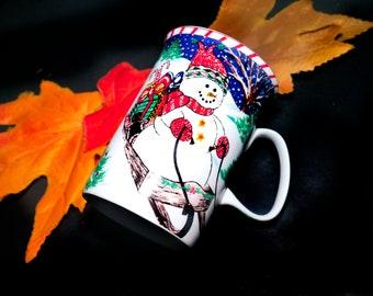 Vintage (1990s) Royal Heritage Christmas coffee or tea mug. Snowman riding on sled with presents, candy cane border.