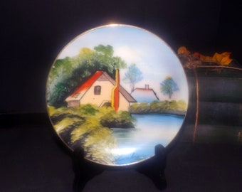 Early mid-century signed hand-painted Nippon plate. Japanese landscape, gold edge. Signed by the artist Kuriki.