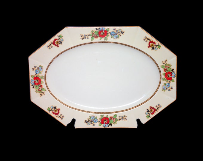 Art deco (1930s) Myott Son & Co pattern 2761 multi-sided oval meat or vegetable platter made in England. Red blue florals, yellow trim.