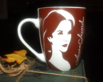 Vintage (1990) Laura Secord Chocolates coffee, tea or hot chocolate mug. Brown-and-white line drawings of Laura Secord.