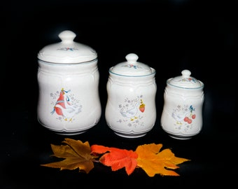 Set of three vintage (1980s) Marmalade stoneware canisters made in Taiwan by International Stoneware. Geese blue ribbons fruit.